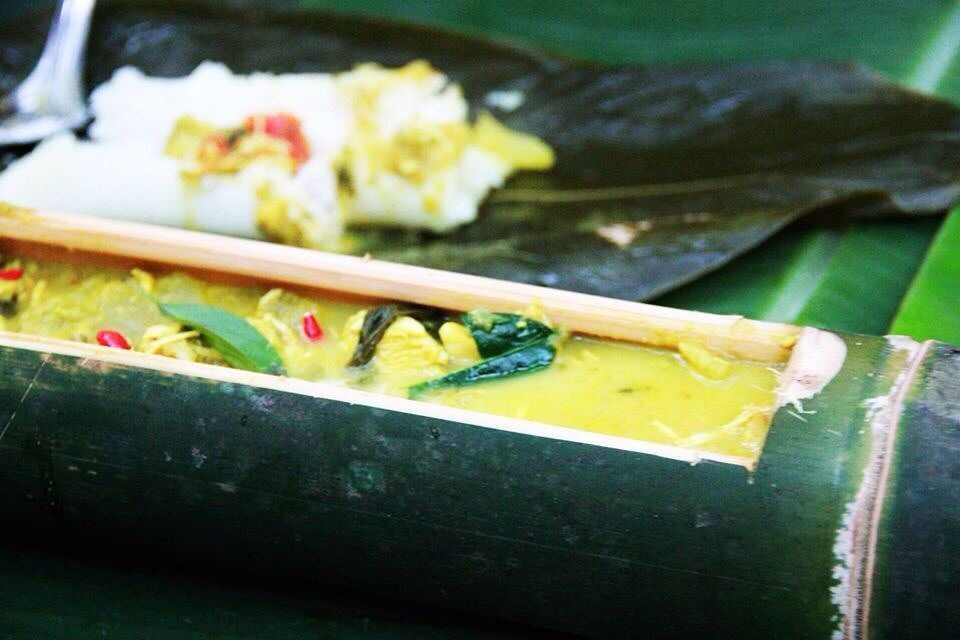 Khao Sok jungle cooking green curry in a bamboo serving dish.